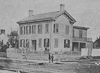 Lincoln in front of his Springfield home